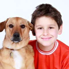young boy with big dog